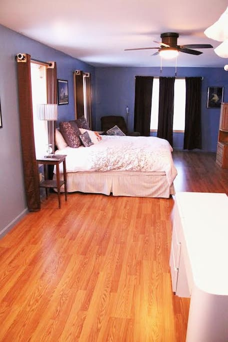 King size bed in a spacious bedroom upstairs.