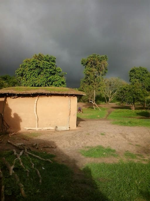 One of our huts with a rainstorm brewing in the distance