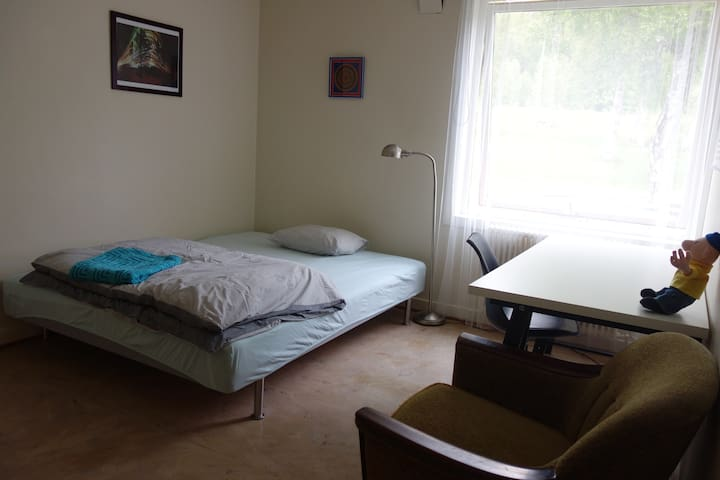 Separate room with a double bed