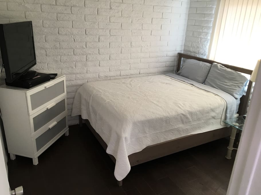 Queen size bed with TV and DVR