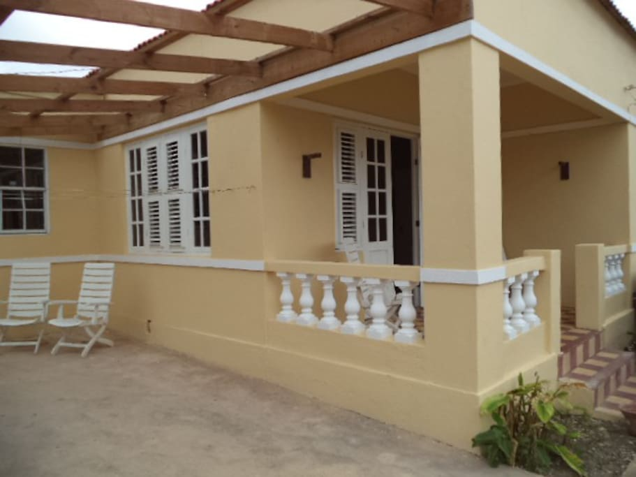 This is a large terrace, whith a lot of room for family and friends.  It is covered for sunshine as well as for rain.