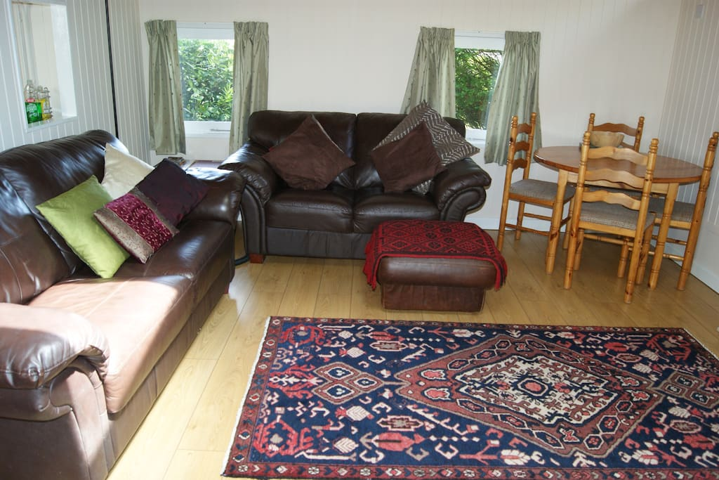 comfortable and well designed living area with wide French doors opening to decking area.