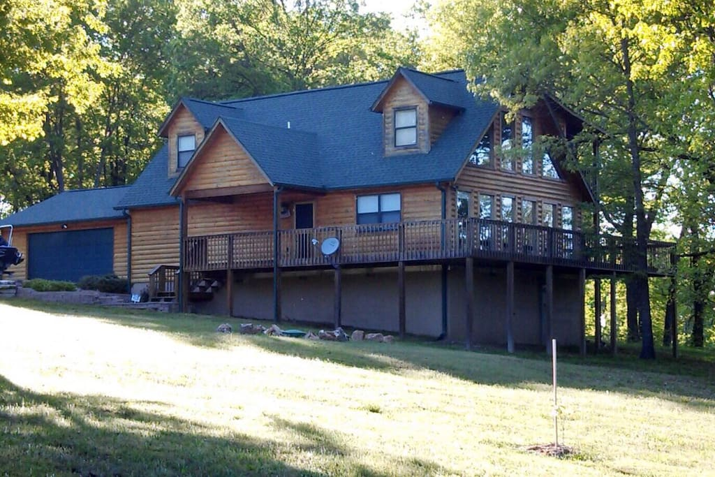 Front of house w/ wrap around deck