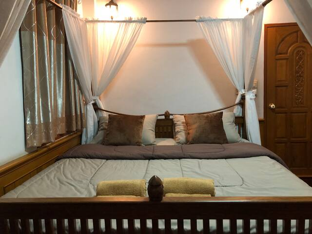 Private king size bed at Ping Riverside
