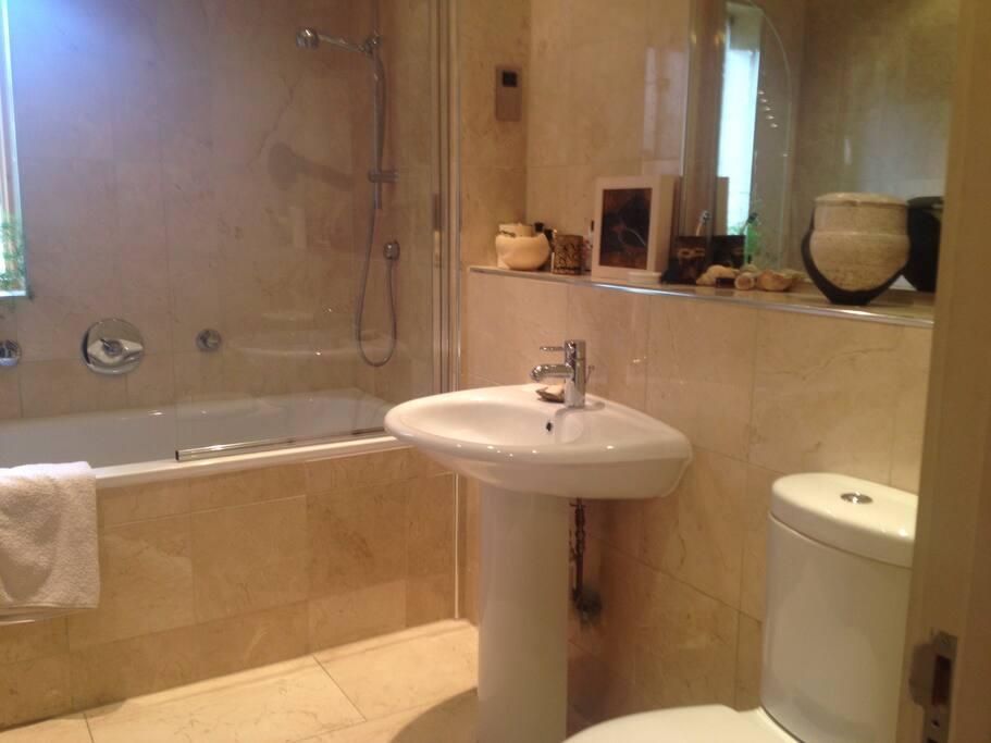 Main bathroom with bathtub and power shower.