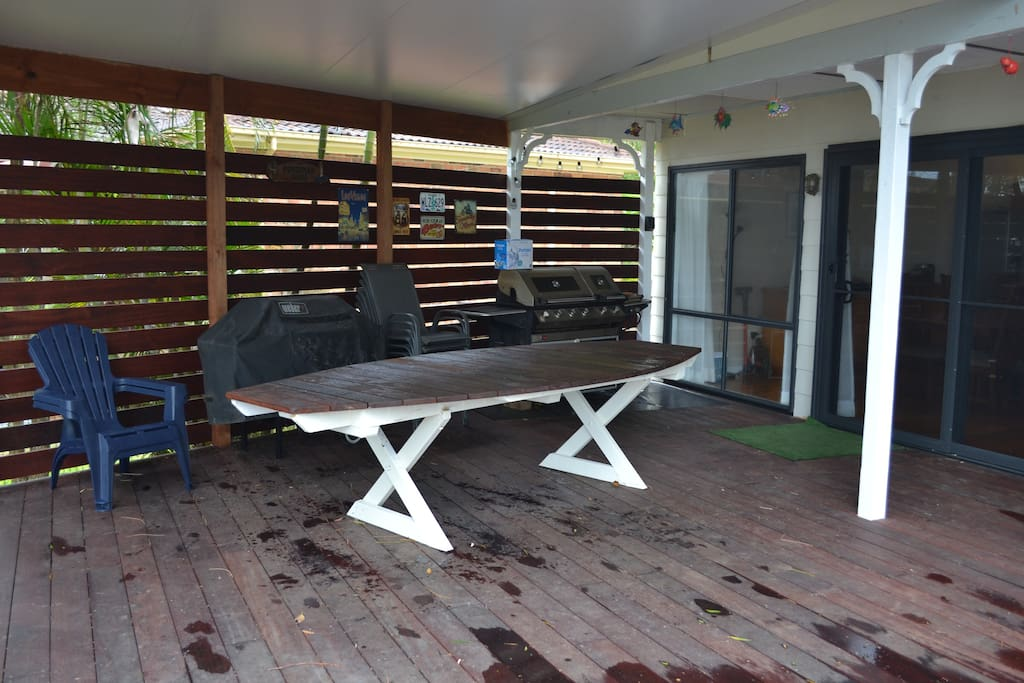 Undercover area under deck. Large table can take 12 easy.