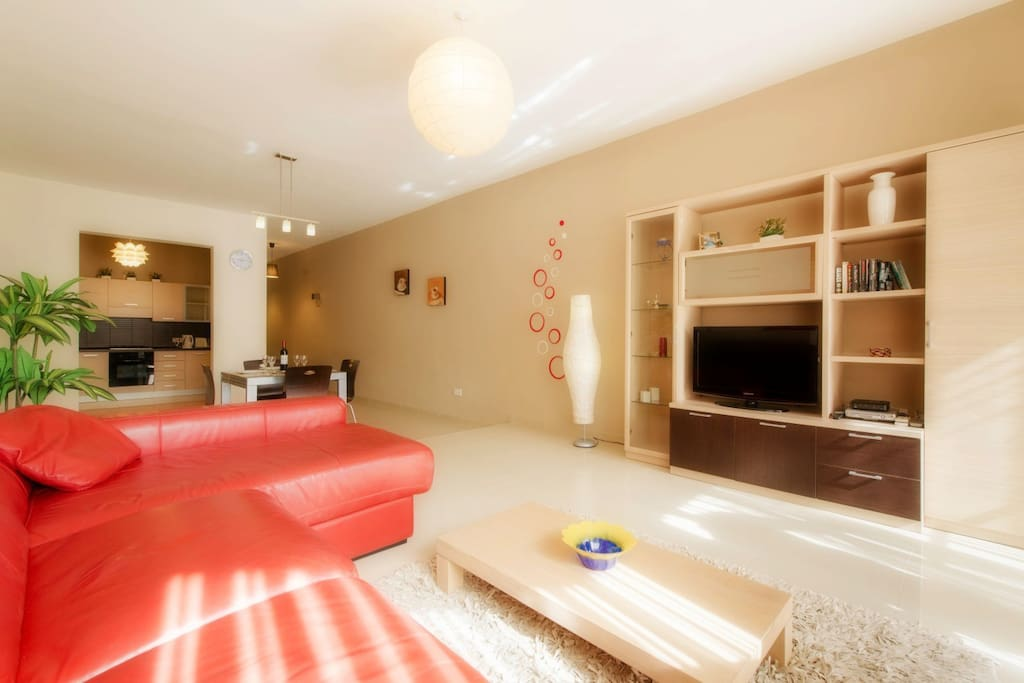 Spacious Living Area with Leather Sofa and LCD TV