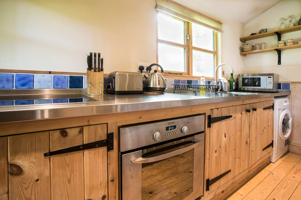 Kitchen with stainless steel worktop and oven