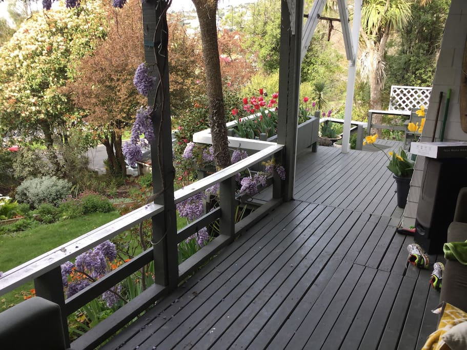 Private outdoor covered deck with spa