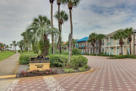 Lakefront condo with water/beach views and a shared pool!
