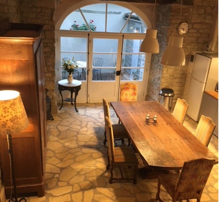Open plan dining and kitchen leading onto private courtyard with BBQ