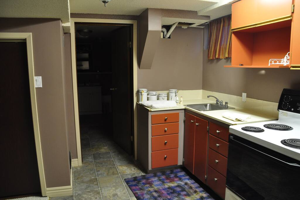 Kitchen area including stove and oven/sink.