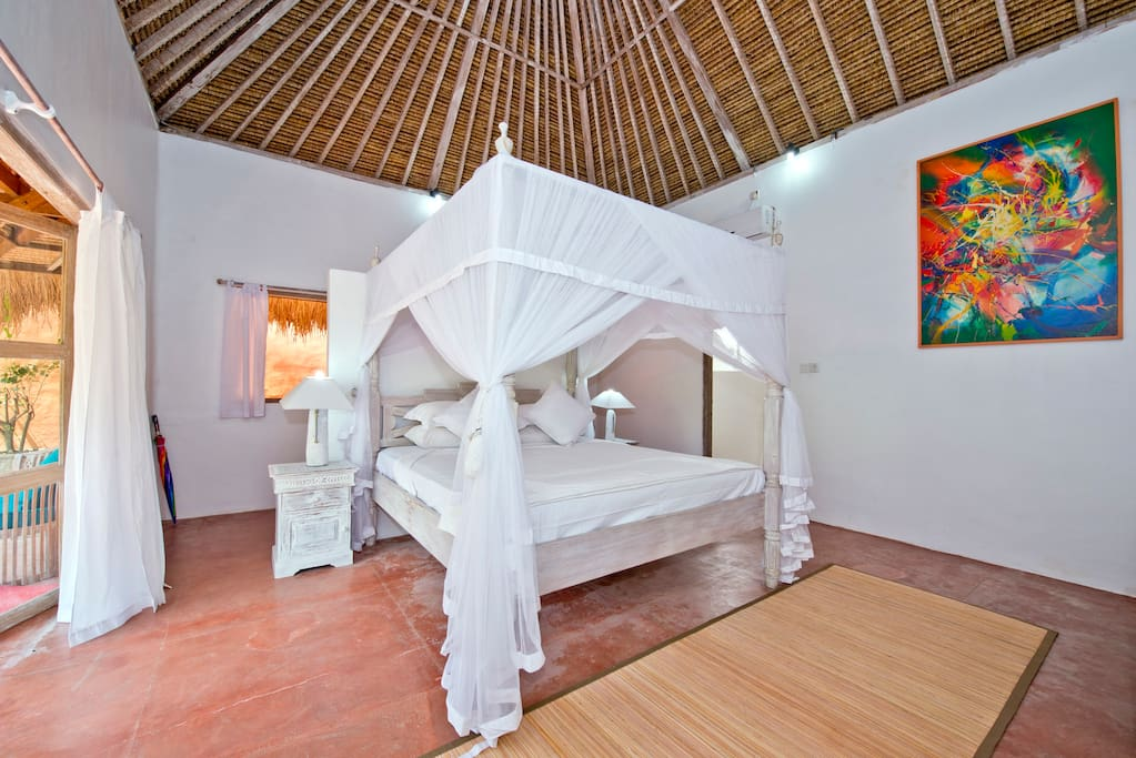 The 'Bourgainvillea' room includes an adjoining modern en-suite complete with all amenities.