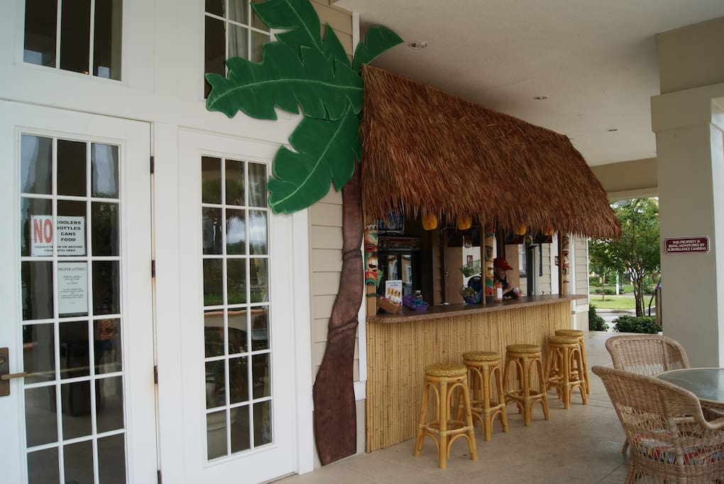 Steps to the house! Enjoy a refreshing drink at our Tiki Bar.