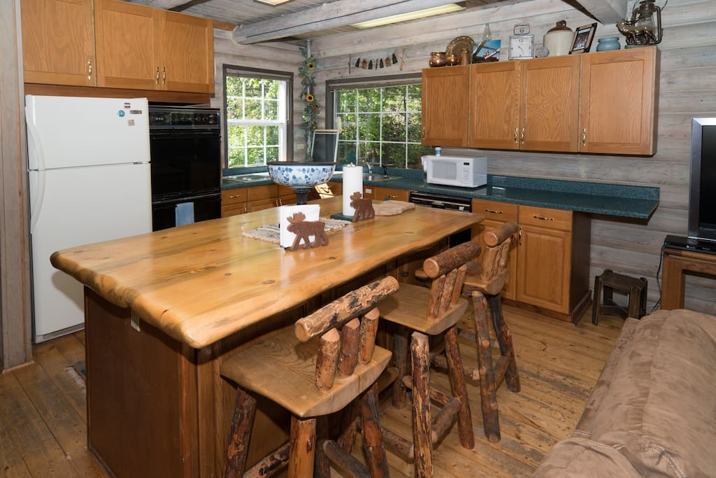 Main floor kitchen sits on the left when you walk through the front door.
