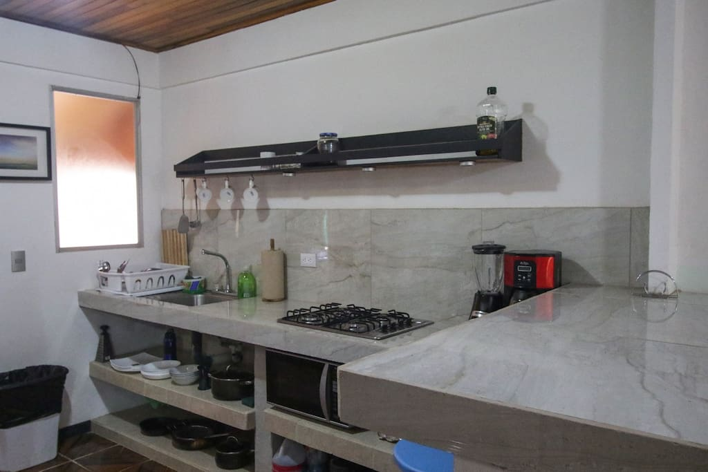 fully equipped kitchen (microwave, full size fridge, coffee maker, blender, stove, bread toaster)