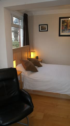 Double bed with King Size duvet, bedside tables, bedside lamps and plenty of sockets.