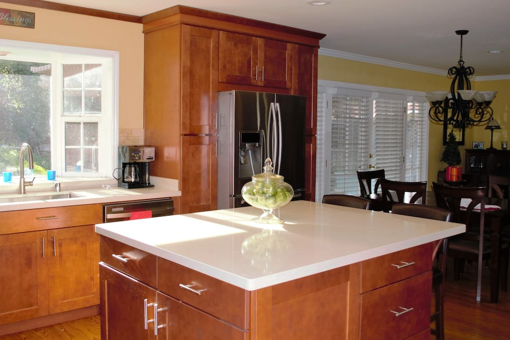 Newly, remodeled kitchen with quartz counter tops .Enjoy cooking while  catching  the afternoon sunshine in this kitchen.