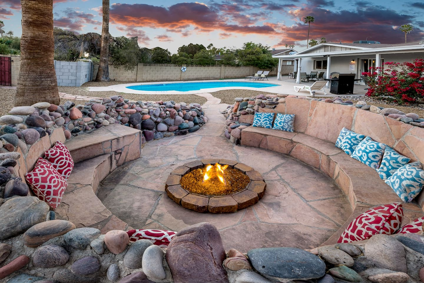 Hang out poolside as the sun goes down next to the glowing fire pit.