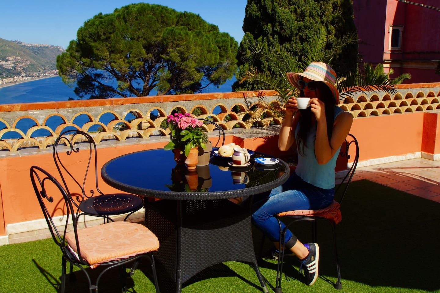 enjoy a cappuccino on terrace with amazing view and at the same time being in the center of Taormina