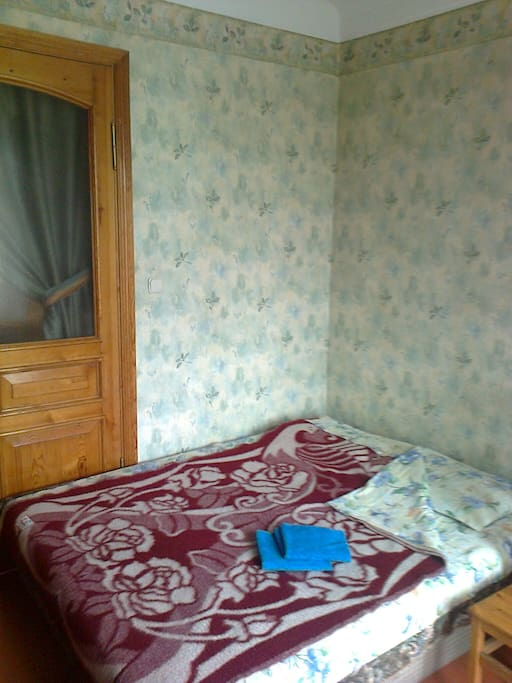 Light and cozy room with a double bed suits couples