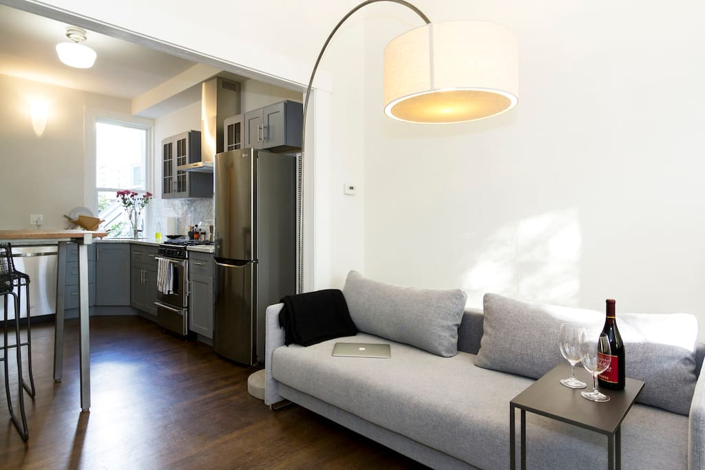 The kitchen and living area play together :) The deep European sofa transforms into a comfortable (firm) queen-sized bed.