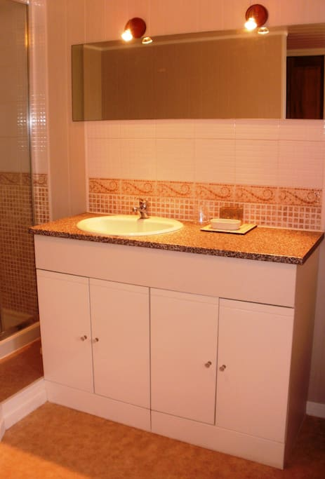 Beautiful large sunny bathroom with double vanity unit