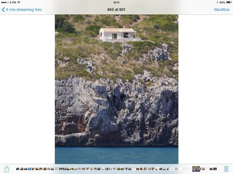 View from the sea to chalet Tango, set directly on the rocky coast