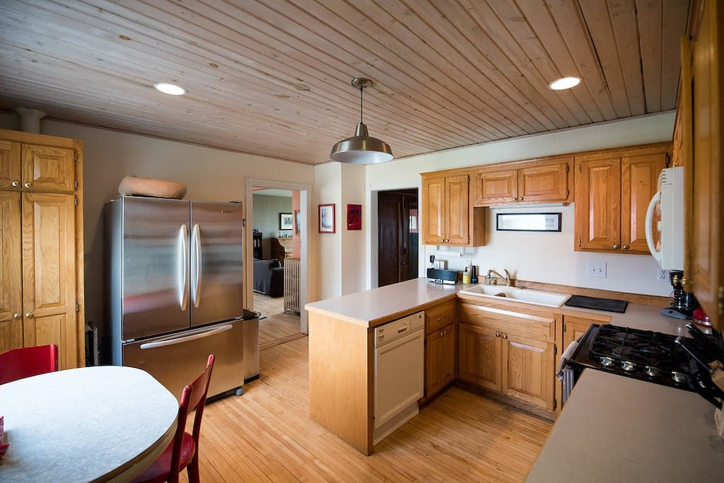 Fully equipped kitchen with oversized refrigerator, dual fuel JennAir stove, convection microhood and Miele dishwasher.