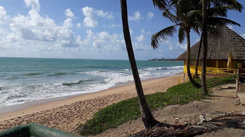 Quarto aconchegante pertinho da praia