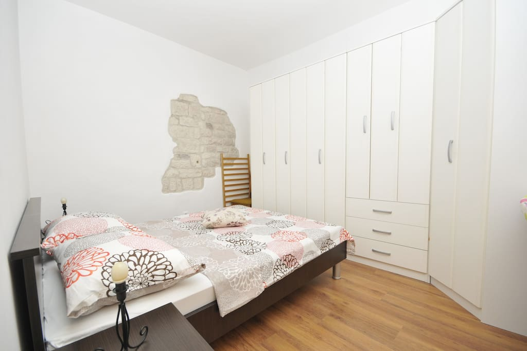 Double bedroom with parts of original, hundreds years old stone walls