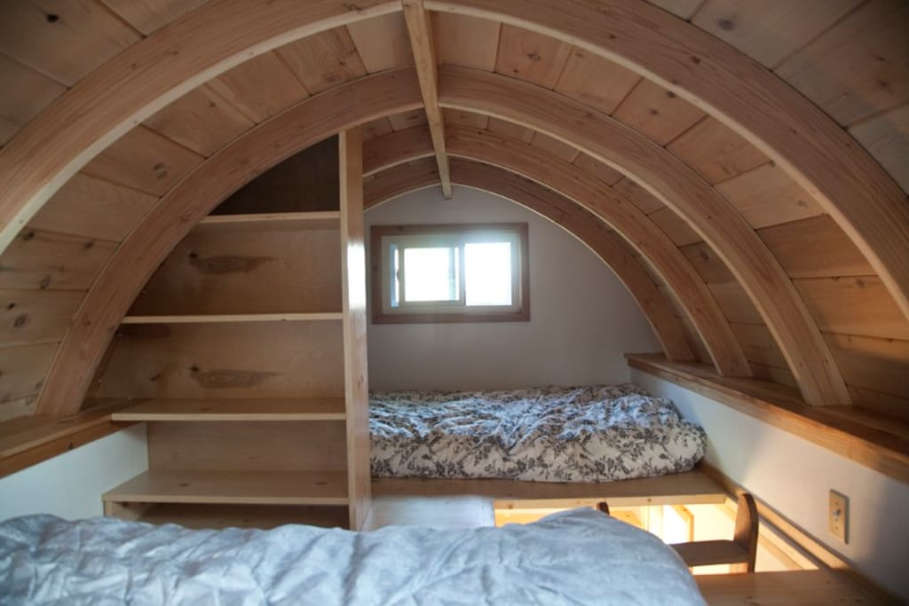 A view from the head of the queen size bed, where you can see the twin bed and plenty of storage space.