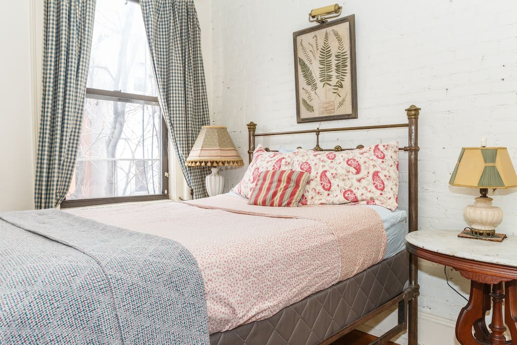 antique brass bed in the sleeping alcove