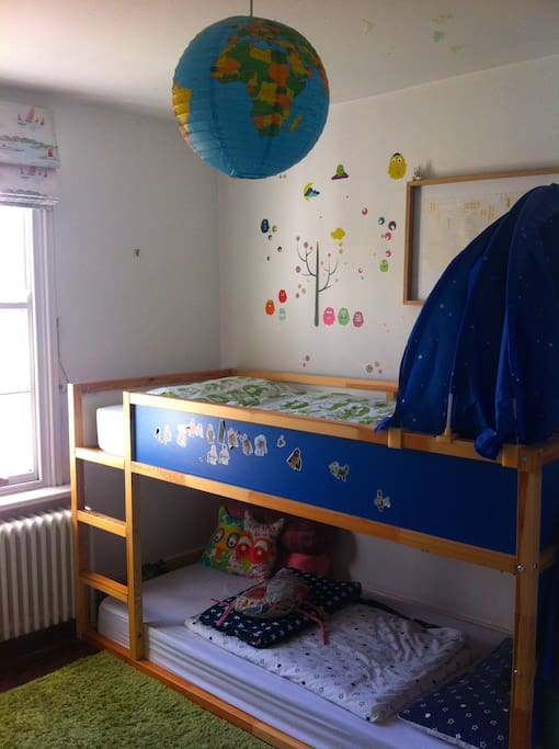 Childrens room with bunk beds. Views onto garden. Lots of toys and books in here.