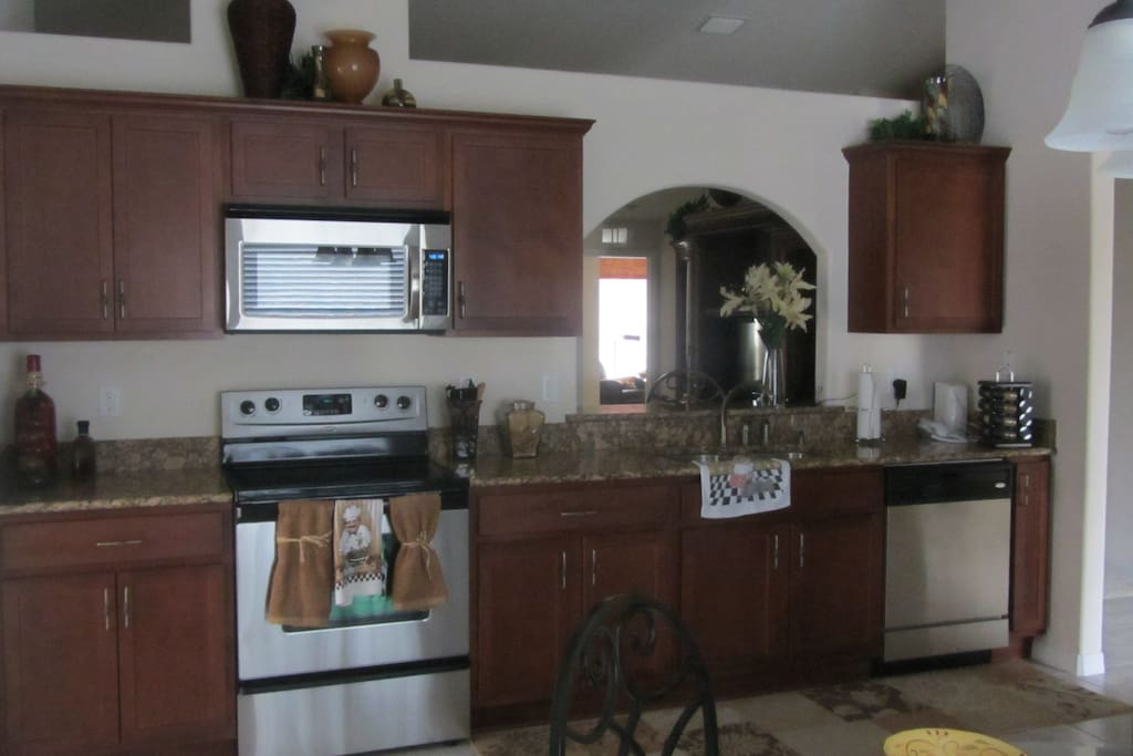 Kitchen with pots and pans, dishes, basically just about anything you need.