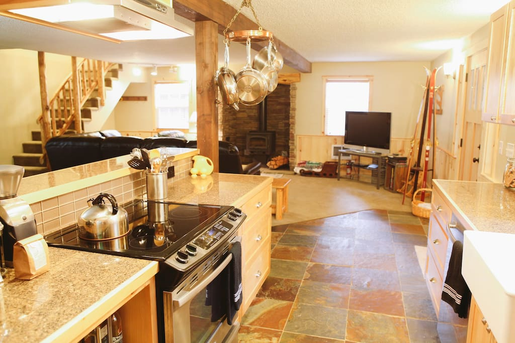 Newly remodeled kitchen with granite countertops is open to the rest of the main floor.