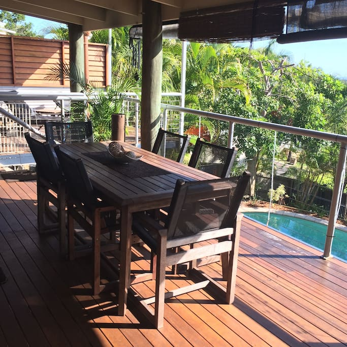 Outdoor casual dining deck with BBQ enjoys magnificent sunsets