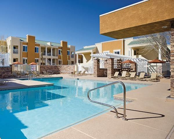 Take a dip at the pool or just relax beside it