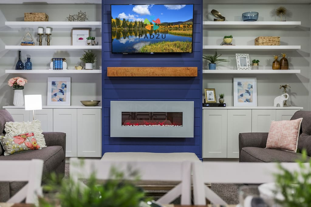 Modern Family Room with electric fireplace and HUGE plasma screen TV