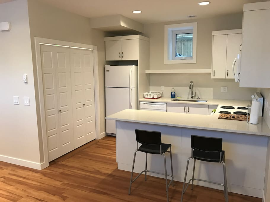 Kitchen area with laundry closet.