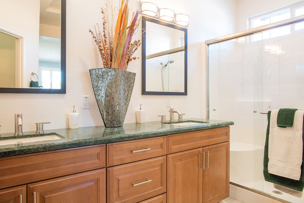 Enjoy getting ready in this spacious, well lit and clean bathroom.  No bumping elbows with this dual sink  marble counter top vanity.