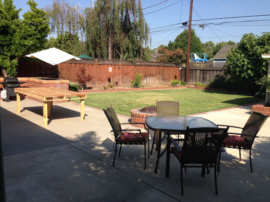 Back yard with BBQ, fire pit, and hot tub.