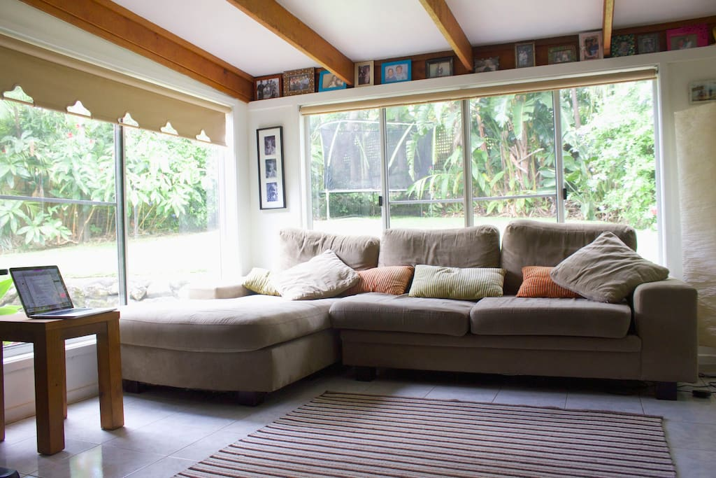 Rear lounge room with huge windows to catch the afternoon breeze