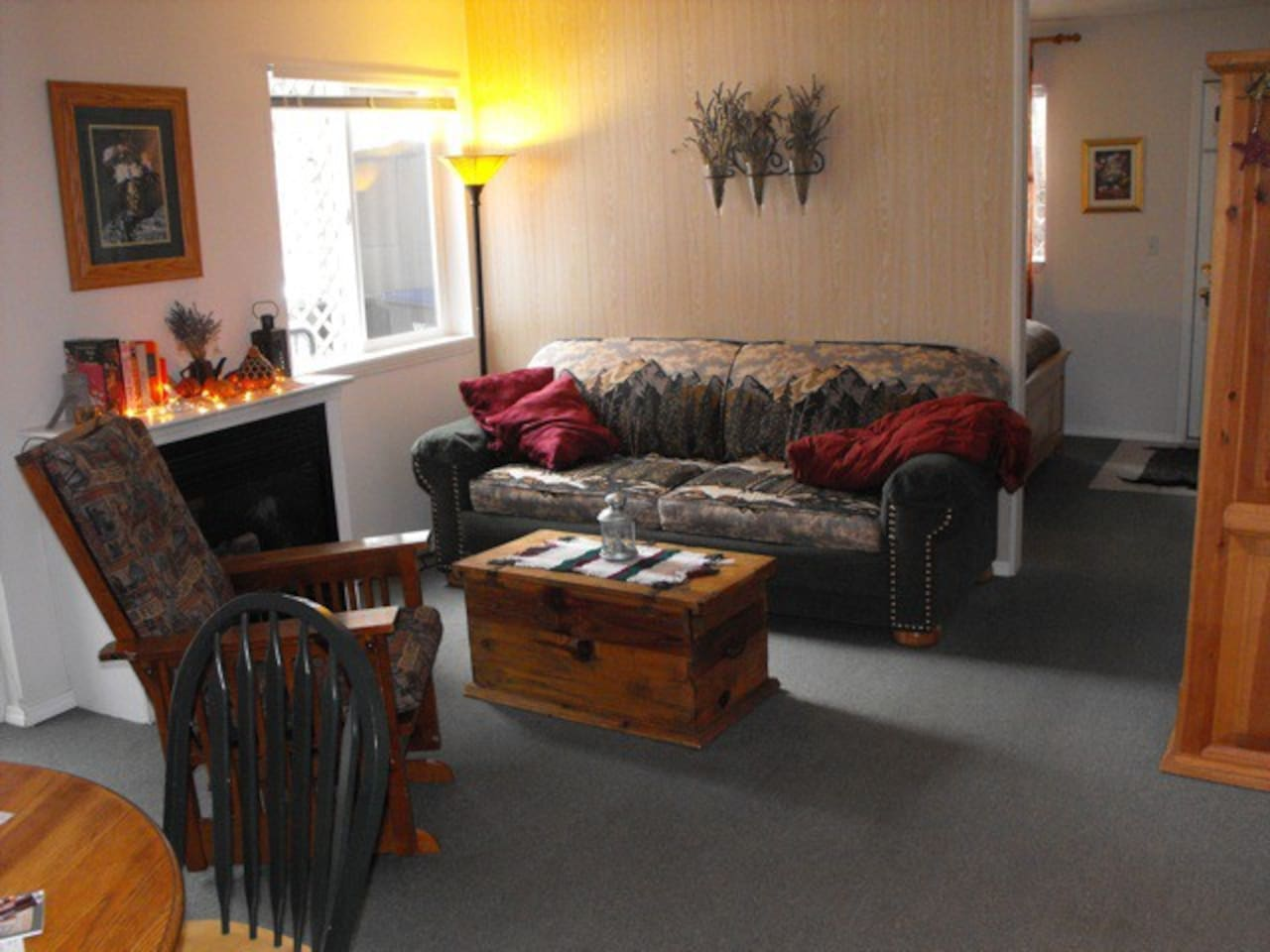 The living space, with queen sleeper couch and gas fireplace.  Sleeping space behind wall....
