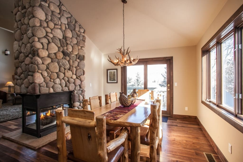 Dining room with seating for 6, double sided gas fireplace, deck with gas grill and access to private fenced yard with hot tub.