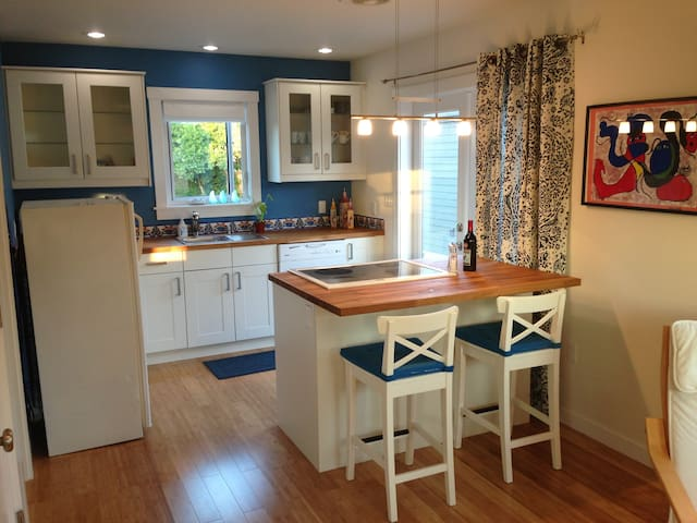 Full Kitchen with stove, oven, dishwasher, refrigerator, coffee pot, etc.