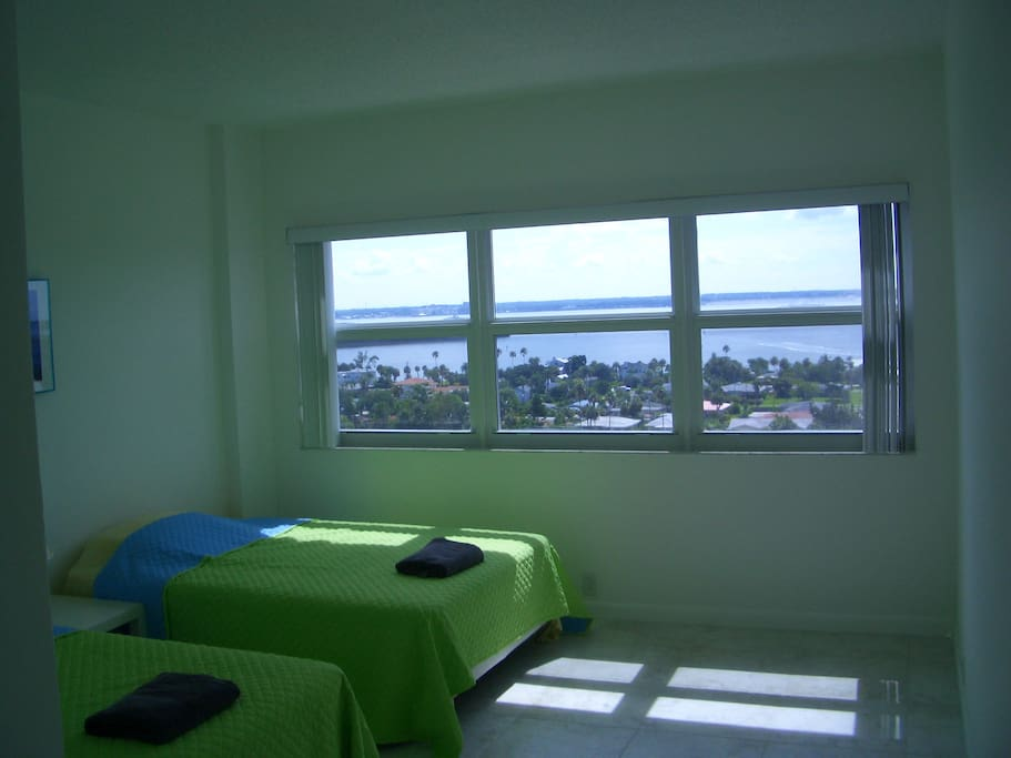 2nd Bedroom Two Full Size beds and tons of closets. It faces the intercoastal waterway, the other side of the building sits on the beach.