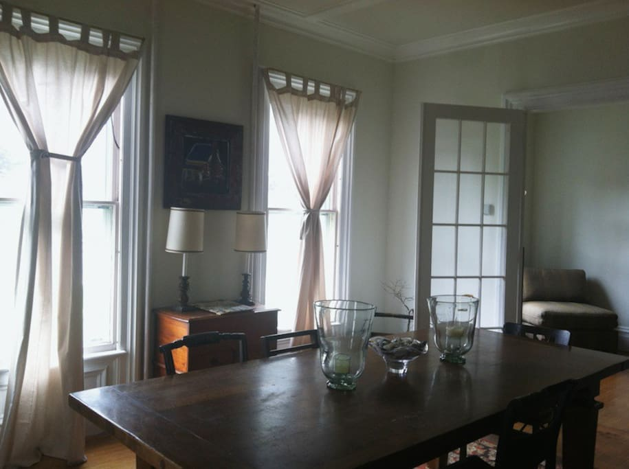 Dining room with french doors leading to piano room