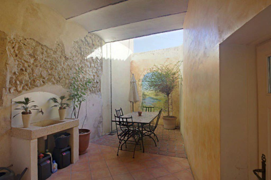 Adjoining the kitchen is this lovely courtyard.