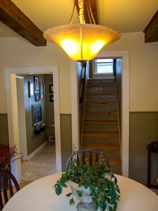 Stairs to second floor off of dining room. Kitchen is to your left through the art hall.